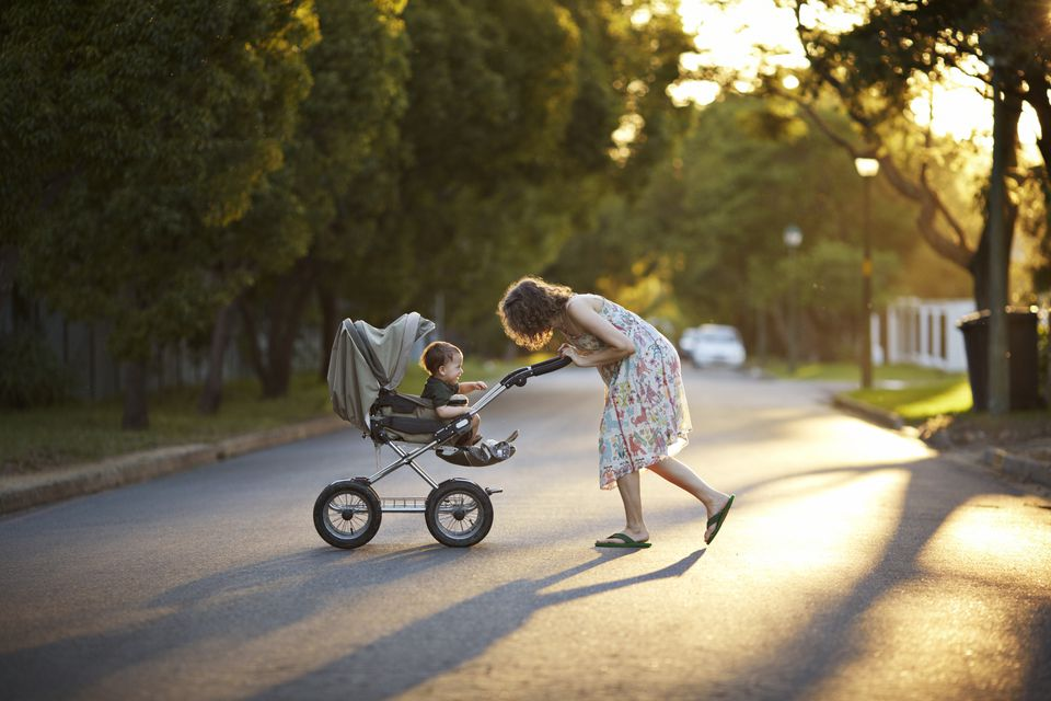 mother---son-walking-with-stroller-in-the-sunset-170872967-5a0216dd9802070037369c48.jpg